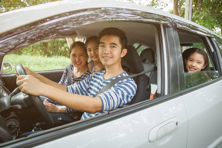Happy Asian family on  van are smiling and driving for travel on vacation Stock Photo