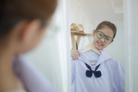 Asian student choosing and dressing school uniform prepare to go school, Back to school Reklamní fotografie