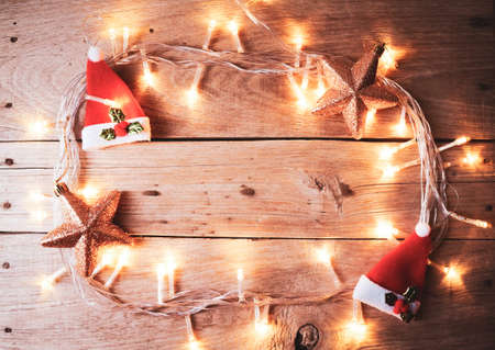 Christmas rustic background - old wood with lights and free text