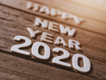 happy new year 2020 alphabet on old wood background