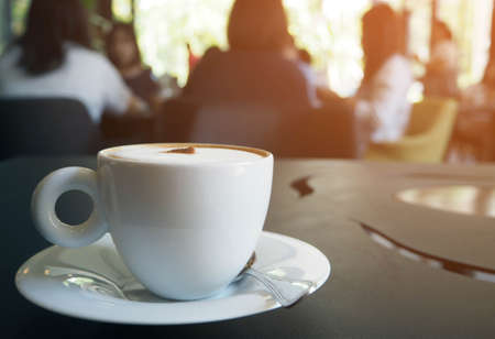 cup of coffee on table in coffee shop cafe