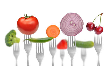 vegetables and fruits on the collection of forks, diet concept Stock Photo