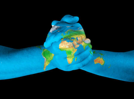 globe in hand: Map painted on hands showing concept of having the world in our hands
