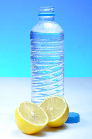 purified: Water bottle and lemon against blue background