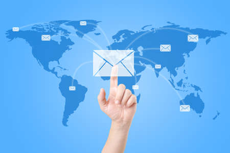 Hands with world mail delivery on world map background  photo
