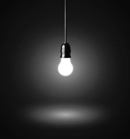 electric bulb: glowing hanging light bulb on a wire Stock Photo