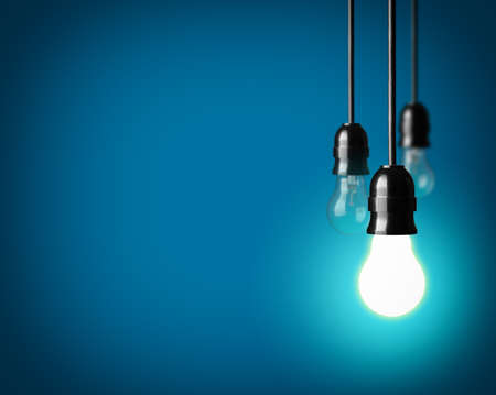 electricity supply: Light bulbs on blue background