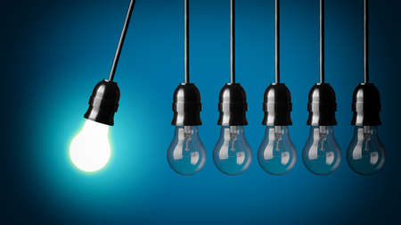 idea bulb: Idea concept on green background  Perpetual motion with light bulbs Stock Photo