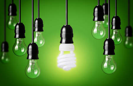 lit lamp: Energy saving and simple light bulbs Green background