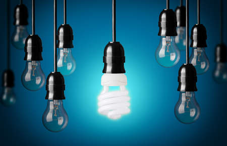 conserve: Energy saving and simple light bulbs Blue background  Stock Photo