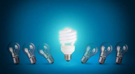 Idea concept with light bulbs and energy save bulb  Blue background  photo