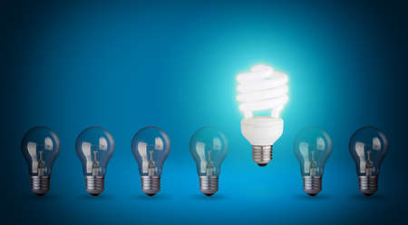 Row with light bulbs and energy save bulb  Idea concept on blue background photo