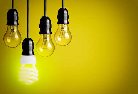 Light bulbs on yellow background  photo