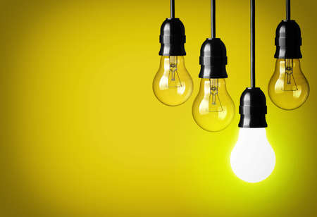 t bulb: Idea concept on yellow background   Stock Photo