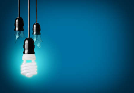 power point: idea concept with broken bulbs and one glowing eco bulb Stock Photo