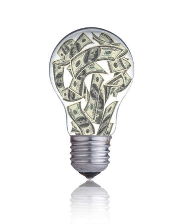 edison: light bulb with money banknotes inside it Stock Photo