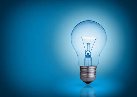 bright idea: light bulb on blue background