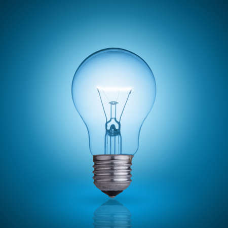 lamp light: light bulb on blue background