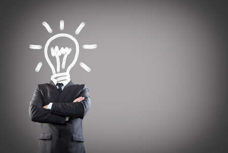 businessman with light bulb head Stock Photo