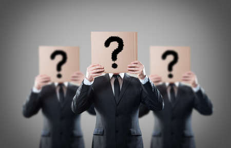reproach: Businessman s holding a card with question Stock Photo