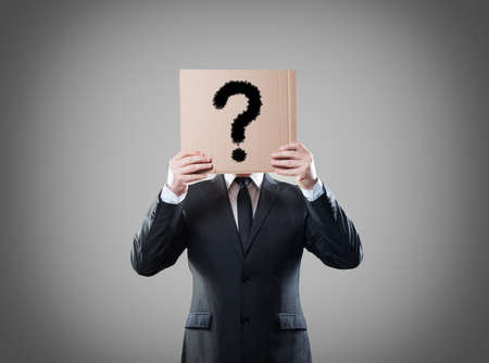 shyness: Businessman holding a card with question  Stock Photo