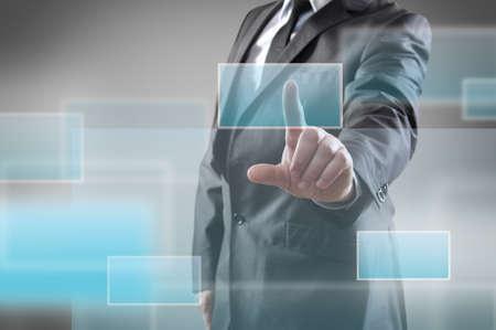 Businessman pressing a virtual button photo