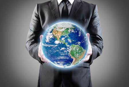 Businessman holds earth in a hands