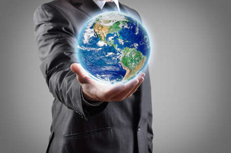 business environment: Businessman holds earth in a hand  Stock Photo