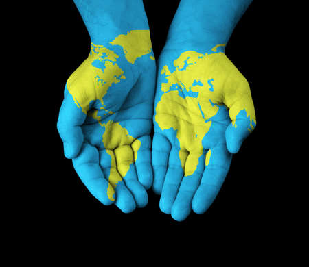 World map painted on hands  photo