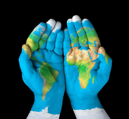 yellow earth: Map painted on hands Concept of having the world in our hands