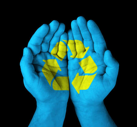 hands with painted recycle symbol  Banco de Imagens