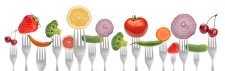 diet concept  vegetables and fruits on the collection of forks Stock Photo