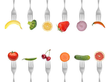 fresh fruits: vegetables and fruits on the collection of forks, diet concept