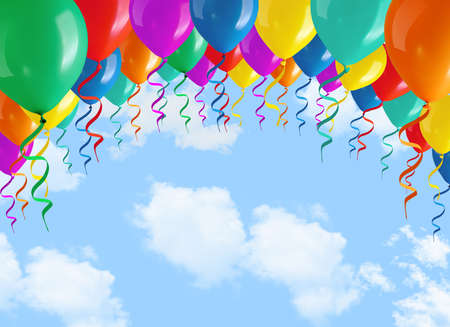 balloons party: colorful balloons on blue sky and clouds