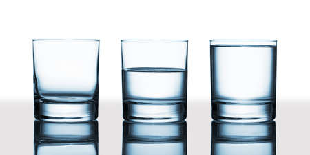 Is the glass half-full or half-empty   Stock Photo