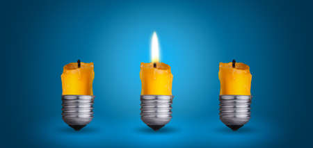 candle into light bulb Idea concept on blue background photo