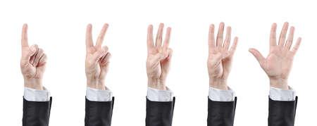 empezar: hombre de negocios contando las manos en el fondo blanco Foto de archivo