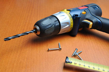 cordless: drill with roulette on wooden below