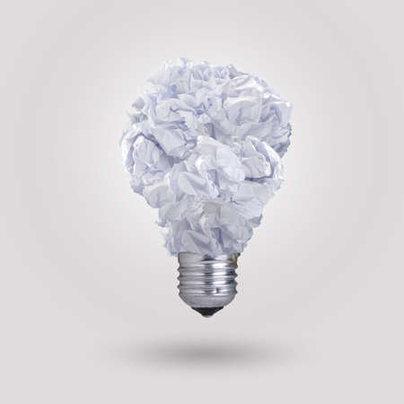 light bulb made of crumpled paper  photo