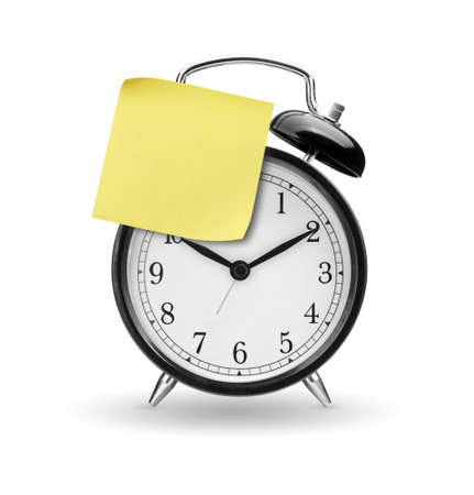 Alarm clock with yellow sticky paper isolated on white  Stock Photo