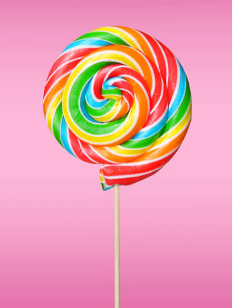 Colorful lollipop on pink background  photo