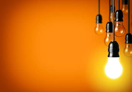 idea light bulb: Idea concept on orange background