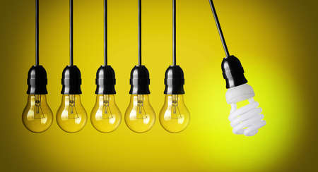 pendulum: Idea concept on yellow background  Perpetual motion with light bulbs