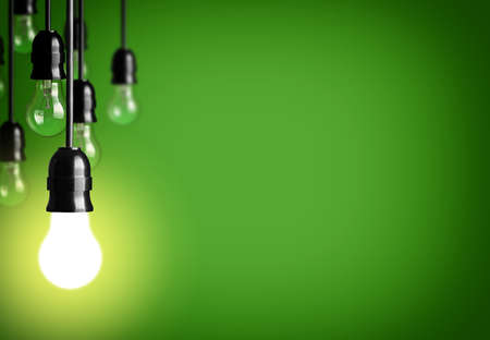 lamp light: Idea concept isolated on green Stock Photo