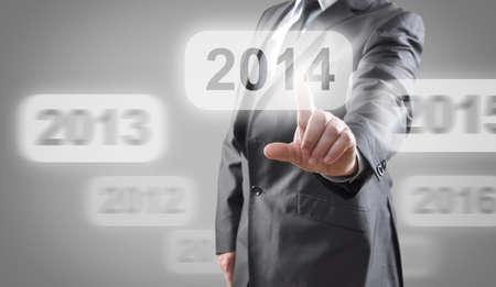selects: Uomo d'affari che seleziona 2014 touch screen Archivio Fotografico