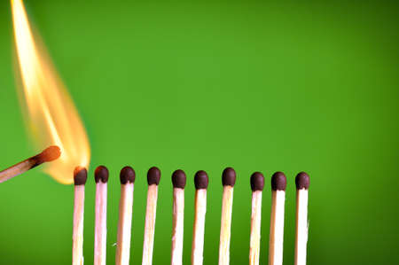 warmness: concept with matches- chain reaction Stock Photo