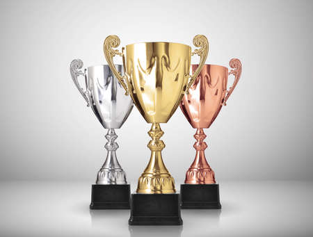 shiny metal background: golden,silver and bronze trophies on gray background Stock Photo