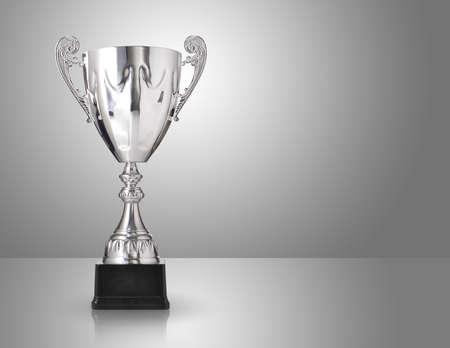 champion silver trophy over grey background 版權商用圖片