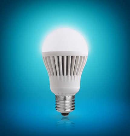 electric bulb: Glowing LED bulb on blue background