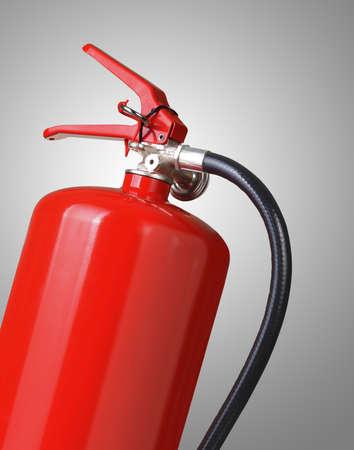 fire extinguishing: fire extinguisher on gray background